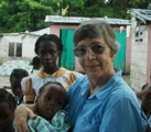 Loretto co-member Barbara Wander with children in Ti Riviere, Haiti