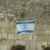 Israeli flag at the Western Wall. Photo by SuperJew via Wikimedia