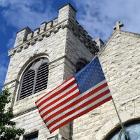 American-Flag-and-church. Public domain image via pixy.com.