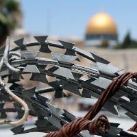 Al Aqsa masue seen through barbed wire. Public Domain image by Pixabay user RJA1988.