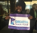 A participant of Faith in Minnesota holds a sign reading GREATER THAN FEAR | Courtesy of Faith in Minnesota's Twitter