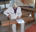 A psalmodikon player (Djurmo School Museum | Wikipedia)