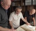 Reviewing manuscripts prior to digitization.