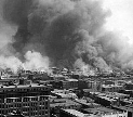 Aftermath of Tulsa race riot of 1921. Public domain image via Wikimedia Commons.