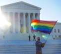 LGBTQ flag being waved in front of the Supreeme Court of the United States. Image licensed under Creative Commons by Ted Eytan, via flickr.