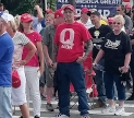 QAnon supporters in red MAGA shirt. Creative Commons image by Marc Nozell