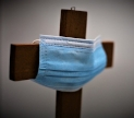 Cristian cross with a surgical mask on it. Public domain image via Pixabay.com