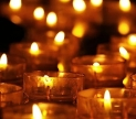 Candels burning in the dark. Public domain image via Pixabay.com