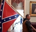 Seditionist with Confederate Battle flag in the United States Capital. Image via ABC News.