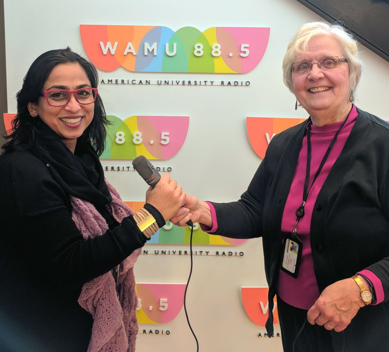 "Maureen ""passing the mic to Executive Producer and host Ambereen Khan"