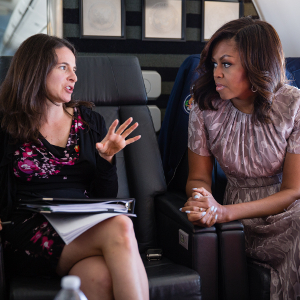 Sarah Hurwitz is pictured speaking with First Lady Michelle Obama aboard a flight from Joint Base Andrews.